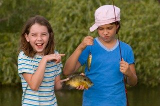 Kids fishing for Bluegills in a Pond